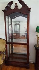 Tall lighted mirrored display cabinet