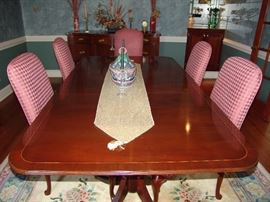 Baker cross banded and double pedestal dining table