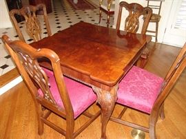 Henredon game table with acanthus carved knees and ball and claw feet and 4 Chippendale style chairs