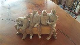 4 men sitting