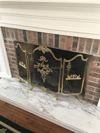 Ornate vintage fireplace screen