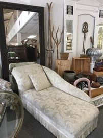 Fainting sofa and large mirror