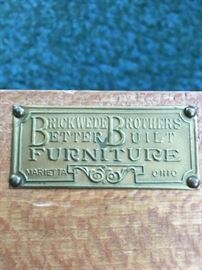 Metal tag on buffet, dining room furniture.