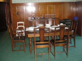Beautiful Dining Room Table with six chairs and three leaves, matches buffet and china cabinet.