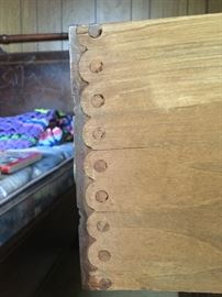 Wood peg dovetails on marble top chest