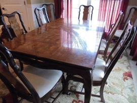Dining table w/8 matching chairs w/burl inlay & 2 leafs & full table pads