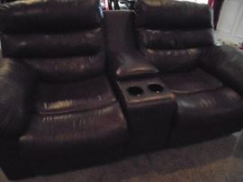 Brown leather love seat w/cup holders