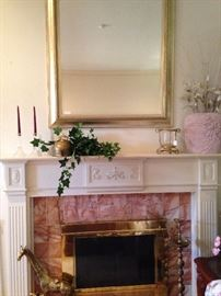 Large gold mantel mirror; brass giraffees and candleholder
