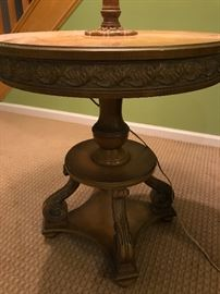 Pedestal Lamp Table.  Leaf motif on carved apron and feathered scrolls on Decorative Base.  Silk Shade with scalloped edges.