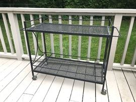 Wrought iron outdoor bar cart on casters.