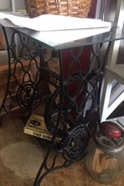 glass top table from antique sewing machine base.