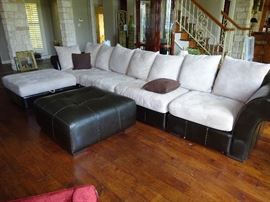 leather/material large sectional with 2 ottomans. one lifts open