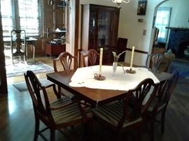 Antique table with 6 chairs.
