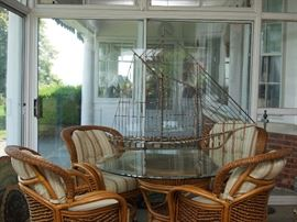 Glass and Rattan casual dining set with 4 chairs
