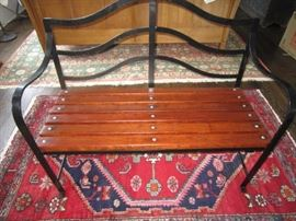 Heavy wrought iron and wood bench