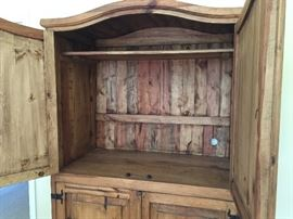 Inside of the top half of the pine Armoire