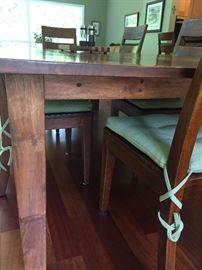 legs of Crate and Barrel Table and 6 side chairs