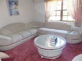 Unique, upholstered in microfiber, sectional with round mirror top table and matching swivel chair.  Table revolves as a lazy susan