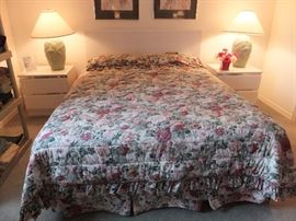 Formica queen headboard and matching night stands.  queen comforter, shams and dust ruffle