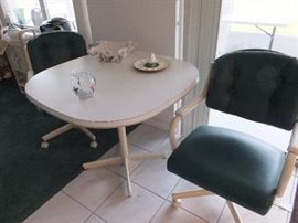 Dinette set with 2 swivel chairs
