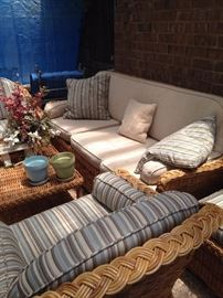 Rattan sofa, 2 chairs, coffee table, and 2 ottomans