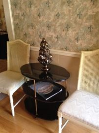 Two of the dining room chairs; black oval 3-tier table