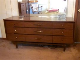 "Mid Century Modern triple dresser by Kroehler.  Six  drawers and large attached mirror.  62"" wide, 18"" deep, 30"" tall."