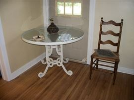 iron & glass table, ladder back chair