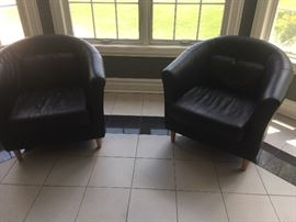 Black leather barrel chairs set of two same as next picture $75 each