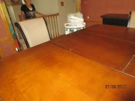 Dining table with leaf popped up