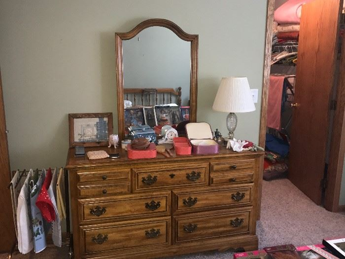 American Drew Dresser with mirror.  There is a matching headboard and night stand to this set. The pieces are priced individually.  There is a double boxspring and mattress included at no charge with the headboard.