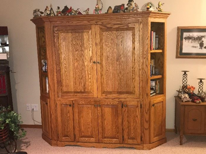 Oak 3 piece entertainment center.   This holds a very large TV. The doors slide back into the cabinet when open.
