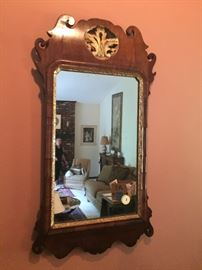 A museum quality English Chippendale Mirror dating from the mid-eighteenth century.  Original gilding and original mirror glass.  Moderate size  perfect to fit over a chest of drawers or hall table.  This is an exceptionally rare piece.