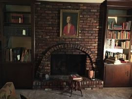 View of Sitting Room with oil-on-canvas portrait of a Monica Jones, artist unknown.  Very well done oil-on-canvas.  Note fine library.