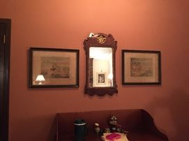A view of the Chippendale mirror with an antique English hunting print hung on either side.  The mirror was imported by Mary Adams Antiques in Birmingham many years ago and is the best of its kind.