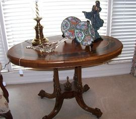 Outstanding antique table with gorgeous graining and decor on surface