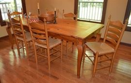 Pine board dining room table & 6 rush bottome chairs