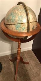 World Globe on wooden stand.