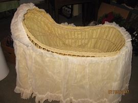 Antique cradle with skirt.