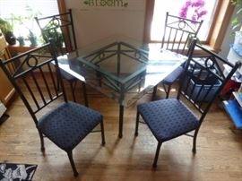 Wrought Iron and Glass Table with Matching Wrought Iron Upholstered Chairs