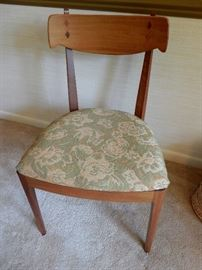 ONE OF THE FOUR WALNUT CHAIRS