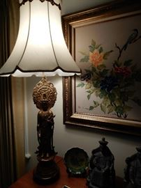 THIS LAMP IS SO HEAVY AND BEAUTIFUL--COULD BE BRASS OF BRONZE.