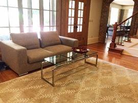 """Saba""   Italia sofa   (as is)      and glass top table , area rug"