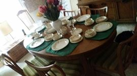 mid century table and 6 chairs   vintage set of china. There are 3 leaves with this table