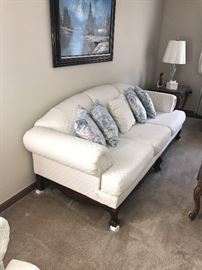 CREAM SOFA WITH WOODEN BALL AND CLAW FEET