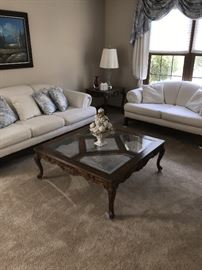 ORNATE WOOD AND GLASS COFFEE TABLE