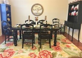 Dining room: black wooden furniture accented with yellow, red, and neutral tones