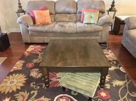 Two full-size microsuede taupe sofas in great condition; coffee table; sage-green microsuede footstools (there is a matching pair); brown floral wool hooked rug no stains