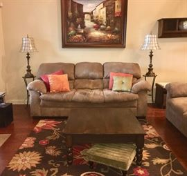 Front view sofa, coffee table, plus vintage cast-metal lamps with capiz-shell shades; scenic art