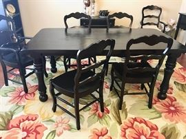 Dining table with six chairs (two captain style) is maple painted black, heavy and sturdy